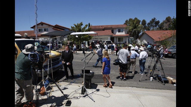 Television news crews gather in front of the home of Robert and Arlene Holmes, parents of 24-year-old mass shooting suspect James Holmes, in San Diego, California, on Friday.