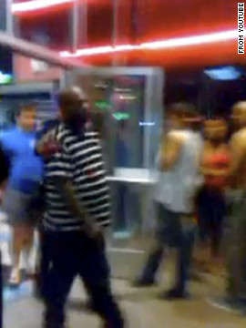 Cell phone video taken by someone at the theater showed scores of people screaming and fleeing the building. Some, like this man, had blood on their clothes.