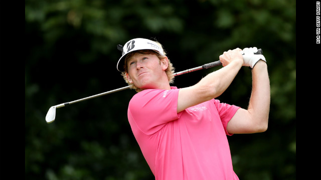 Snedeker hits his tee shot on the first hole Saturday.