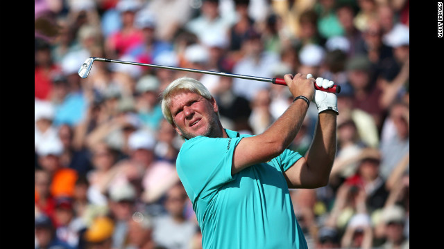 American John Daly swings at the fifth hole. Daly, who won the Open in 1995, struggled to a 77 Saturday and is in next-to-last place.