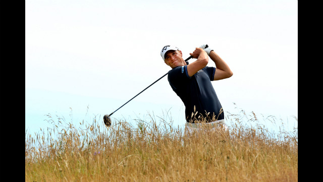 Sweden's Alexander Noren fires a fairway wood shot over the long grass at the 11th hole Saturday.