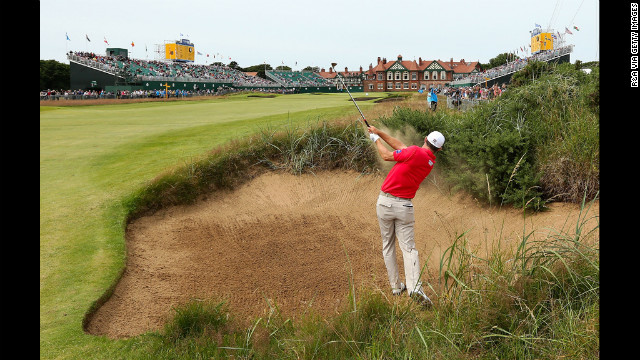 Ireland's Padraig Harrington blasts from a bunker on the 18th hole Saturday.