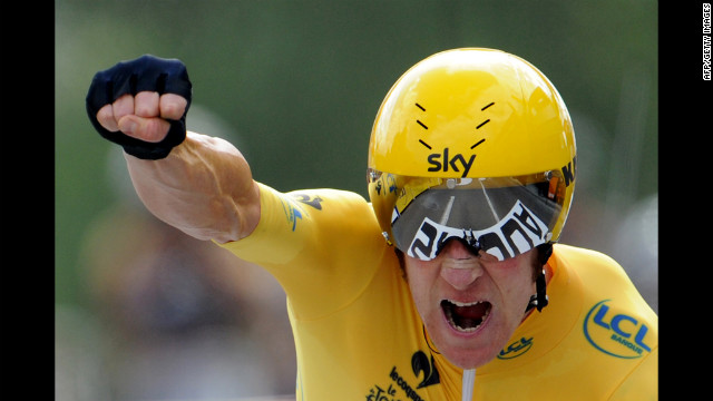 Briton Bradley Wiggins, wearing the leader's yellow jersey, celebrates finishing the 19th stage of the 2012 Tour de France on Saturday, July 21.