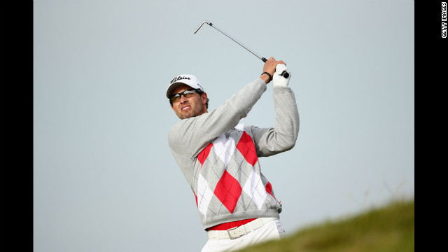 Adam Scott of Australia hits an approach shot on Saturday, July 21, at Royal Lytham & St. Annes Golf Club in England during the third round of the British Open on Saturday. Scott finished with a four-shot lead going into the final round of golf's oldest major championship