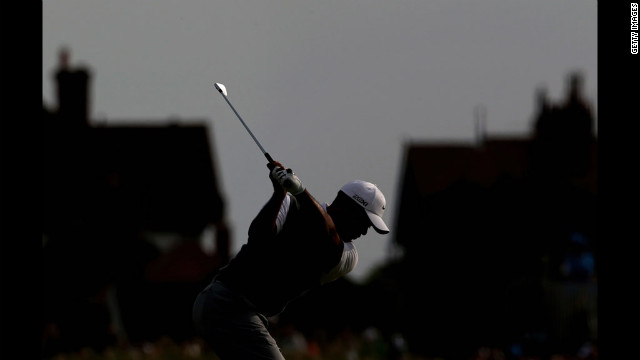 Tiger Woods hits his second shot on the 17th hole on Saturday. Woods finished the third round alone in fourth place, five shots behind Adam Scott.