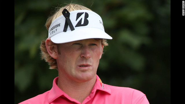 Brandt Snedeker of the United States wears a ribbon in sympathy for the Aurora, Colorado, shootings during the third round of the British Open on Saturday.