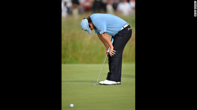 Jason Dufner of the United States reacts to a missed putt on the 17th green. Dufner struggled to shoot 73 on Saturday and is 10 shots out of the lead.