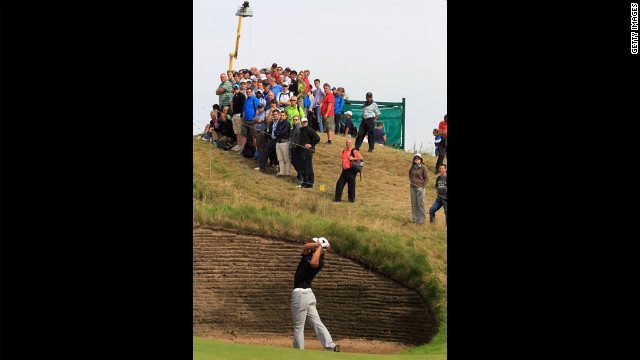 Spectators watch Olesen extract himself from one of Royal Lytham &amp; St. Annes' many bunkers on Saturday.
