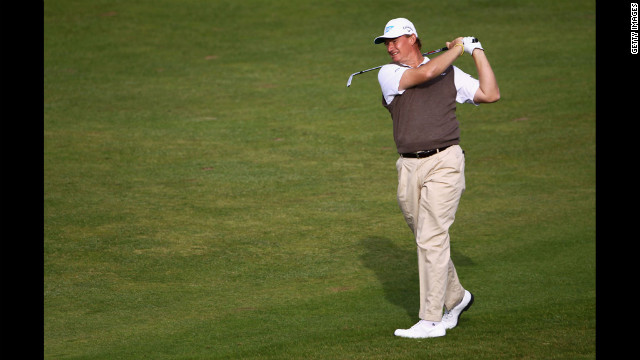 Ernie Els of South Africa hits an approach shot. Els, a three-time major champion, is tied for fifth place with American Zach Johnson, six shots out of the lead.