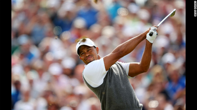 Woods follows through on his drive at the fifth. 