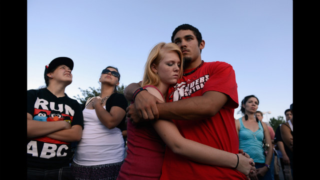 Lonnie Delgado, right, hugs Heaven Leek during a prayer.