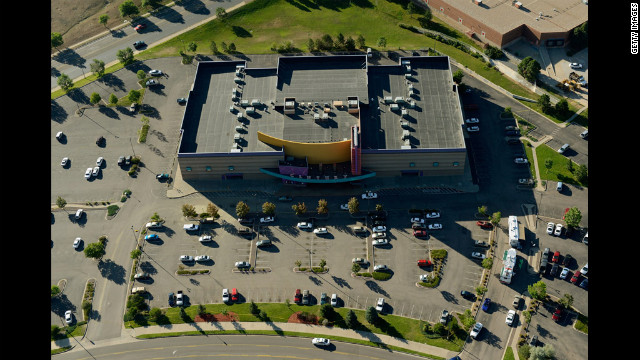 Police investigate outside the Century 16 multiplex Saturday, July 21, a day after the mass shooting. Authorities have been tight-lipped about a possible motive in the case.