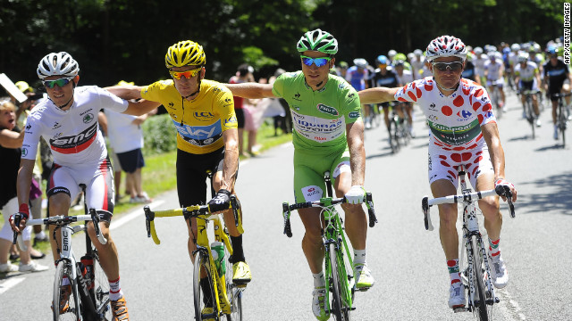 From left, best young rider Tejay Van Garderen of the United States, overall race leader Bradley Wiggins of Great Britain, best sprinter Peter Sagan of Slovakia and best climber Thomas Voeckler of France ride together the final stage, which is largely ceremonial.