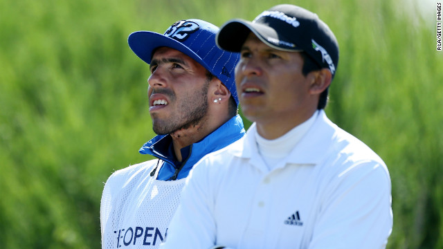 Andres Romero of Argentina, right, and his guest caddie, soccer player Carlos Tevez of Manchester City, watch the action from the tee on the 12th hole Sunday.
