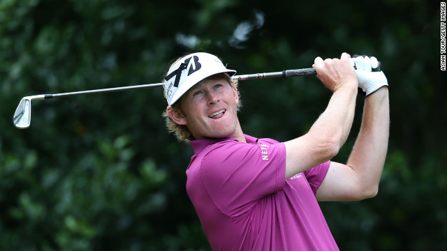 Brandt Snedeker of the United States, who started the day in second place at -7, hits his tee shot on the first hole Sunday.