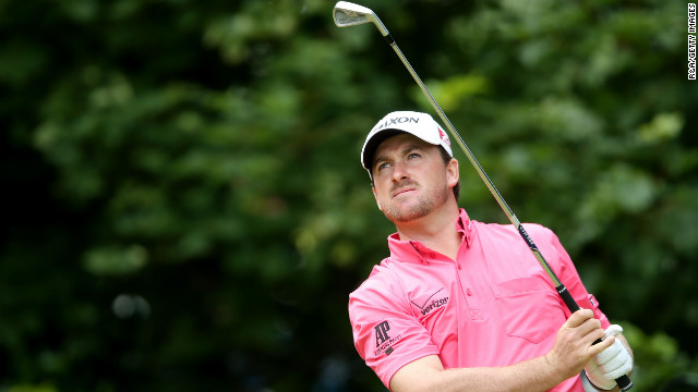 McDowell tees off on the first hole Sunday.