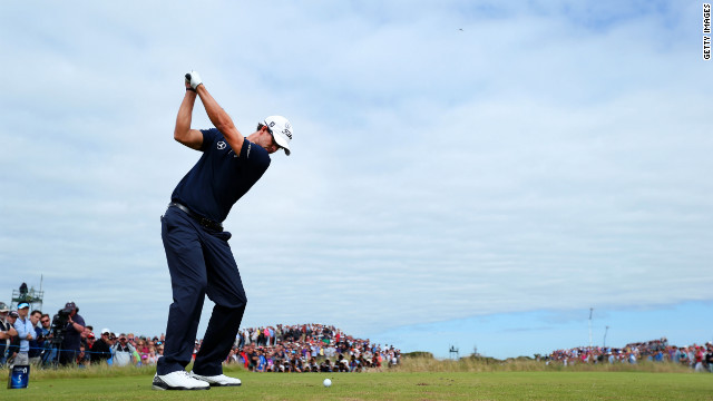 Overall leader Adam Scott of Australia hits his tee shot on the fifth hole Sunday.