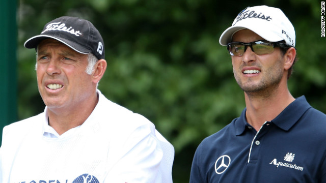 Scott and caddie Steve Williams watch the action on the first hole Sunday.