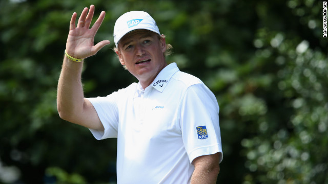 Ernie Els of South Africa, who began the day at -5, waves to spectators from the the on the first hole as he begins the final round Sunday.
