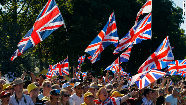 British fans celebrate during the 20th and final stage of the Tour on Sunday in Paris.