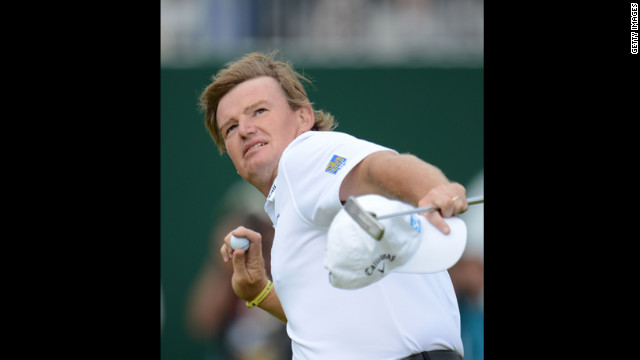 Ernie Els tosses his golf ball to the gallery after a birdie putt on the 18th green on Sunday.