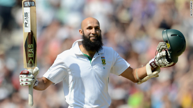Hashim Amla raises his bat in triumph after reaching his triple century milestone at The Oval.