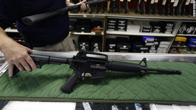 A Bush Master AR-15 assault rifle similar to one used in Friday's rampage is displayed Sunday at a gun shop in Aurora, Colorado.