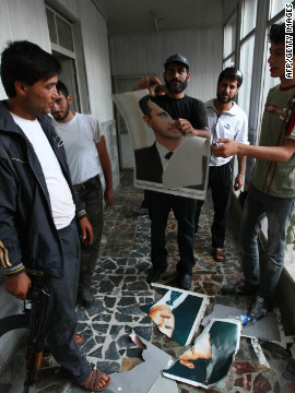 A Free Syrian Army soldier rips a portrait of President Bashar al-Assad at the Bab Al-Salam border crossing to Turkey on Sunday. 