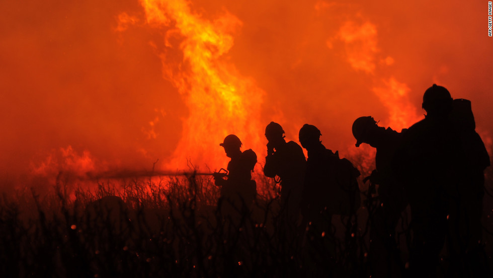 Firefighters fight the flames of a wildfire in Ller, Spain, in the northern Catalonia region on the Spanish-French border on Monday, July 23.