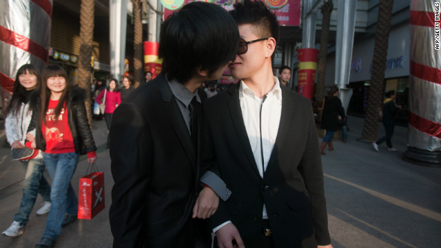 In a picture taken on March 8, 2011, a gay couple kiss during their ceremonial 'wedding' in Wuhan, China.