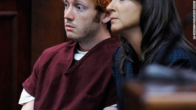 The public gets its first glimpse of James Holmes, 24, the suspect in the Colorado theater shooting during his initial court appearance Monday, July 23. With his hair dyed reddish-orange, Holmes, here with public defender Tamara Brady, showed little emotion. He is accused of opening fire in a movie theater Friday, July 20, in Aurora, Colorado, killing 12 people and wounding 58 others.