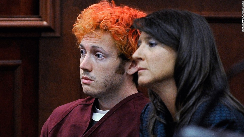 The public gets its first glimpse of James Holmes, 24, the suspect in the Colorado theater shooting during his initial court appearance Monday, July 23. With his hair dyed reddish-orange, Holmes, here with public defender Tamara Brady, showed little emotion. He is accused of opening fire in a movie theater Friday, July 20, in Aurora, Colorado, killing 12 people and wounding 58 others. &lt;a href='http://www.cnn.com/2012/07/21/us/gallery/colorado-mourning-victims/index.html' target='_blank'&gt;More photos: Mourning the victims of the Colorado theater massacre&lt;/a&gt;