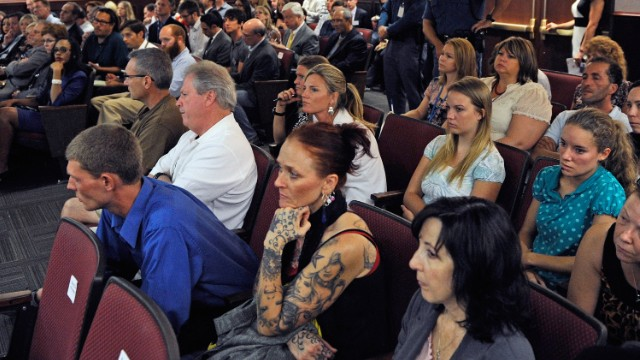 Victims and their relatives and journalists watch the proceedings Monday.