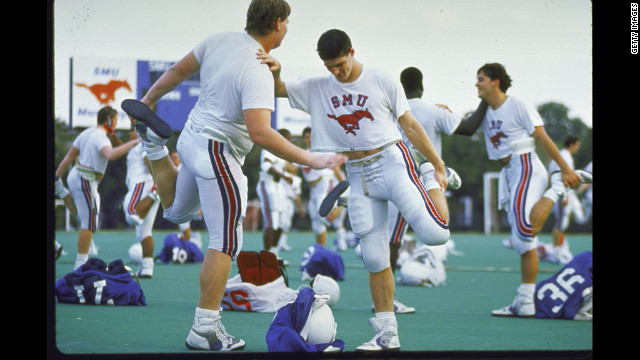The Southern Methodist University football team warms up in 1988, two years after a scandal broke that SMU boosters had been giving football players thousands of dollars from a slush fund with university officials' knowledge. In what was the first and last time it gave the &quot;death penalty&quot; to a football program, the NCAA suspended SMU from playing its 1987 season and banned it from recruiting. The school also was not allowed to play at home in the 1988 season and lost dozens of scholarships.