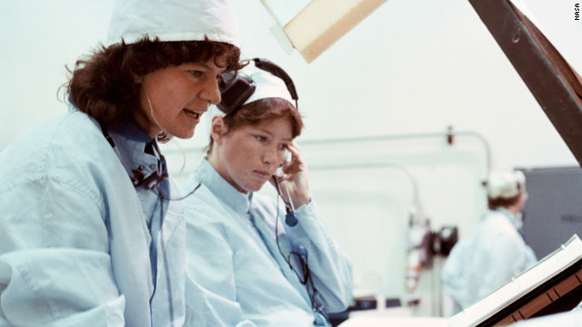 Ride, left, and Anna Fisher work on a mission sequence test as part of their 1978 astronaut class at Kennedy Space Center.
