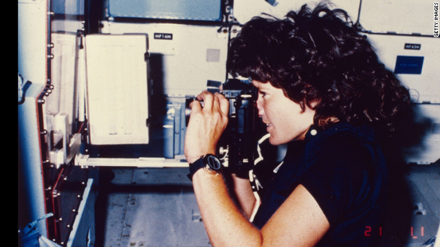 Ride takes a photograph during her Earth orbit on the Challenger.