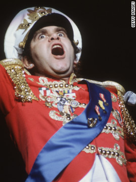 Elton John became known for his over-the-top costumes and theatrical performances.
