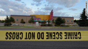 Crime scene tape surrounds the Century 16 movie theater where 12 people were killed in Aurora, Colorado.