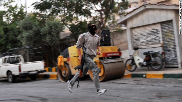A Syrian rebel runs through the streets of Selehattin during an attack on a municipal building. The rebel Free Syrian Army says it is attempting to 