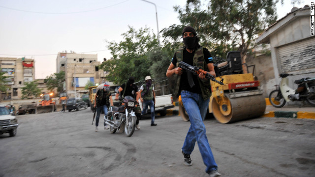 Syrian rebels make their way down a street Monday in Selehattin near Aleppo. If they gain control of Aleppo, it would mark a pivotal point in the Syrian crisis. 