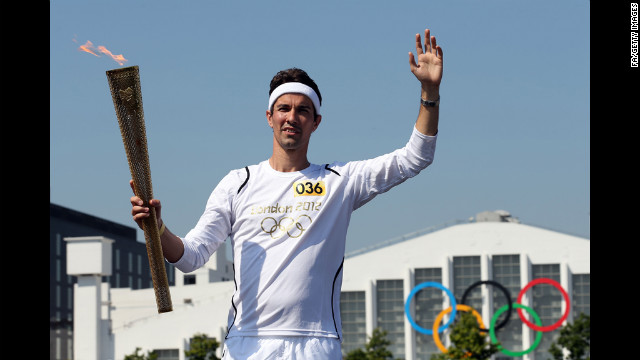 Badminton player Nathan Robertson poses during the handover of the Olympic Torch at Wembley Stadium two days before the Opening Ceremony.