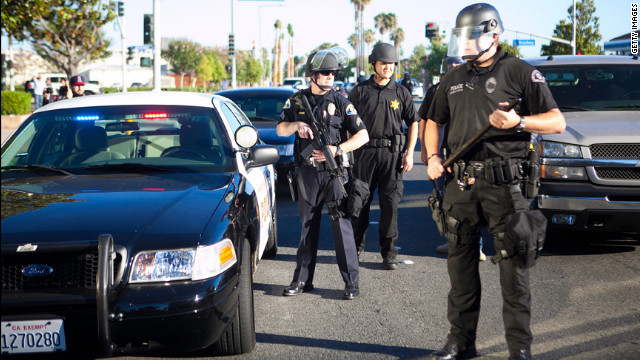 Police stand ready during a protest over the shooting death of Manuel Angel Diaz on Tuesday, July 24, in Anaheim, California. An Anaheim police officer fatally shot Diaz on Saturday, setting off days of protests.