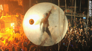 The Flaming Lips\' Wayne Coyne surfs a concert crowd in his space bubble.