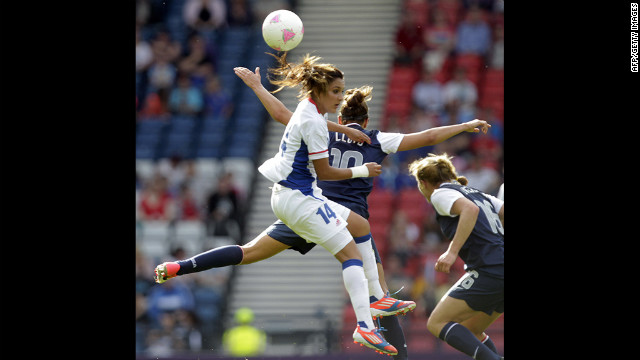France's Louisa Necib, left, is challenged by American Carli Lloyd.