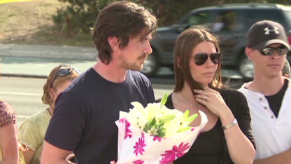 Christian Bale visits shooting victims