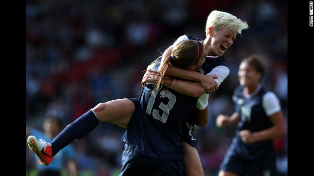 U.S. player Megan Rapinoe jumps on teammate Alex Morgan, No. 13, after Morgan scored during their Group G Olympic women's soccer match against France at Hampden Park in Glasgow, Scotland, on Wednesday, July 25. 