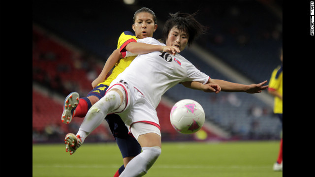 North Korea's Kim Song Hui, in white, vies with Colombia's Natalia Ariza on July 25.
