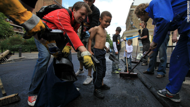 But the day after, when hundreds of volunteers turned up with brooms to help clean up east London's broken neighborhoods, showed an extraordinary sense of community.<br/><br/>