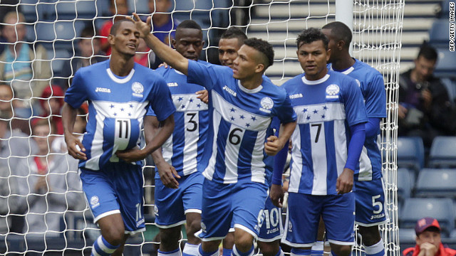 The Honduras men's soccer team celebrates after scoring a goal against Morocco during a first-round match Thursday.
