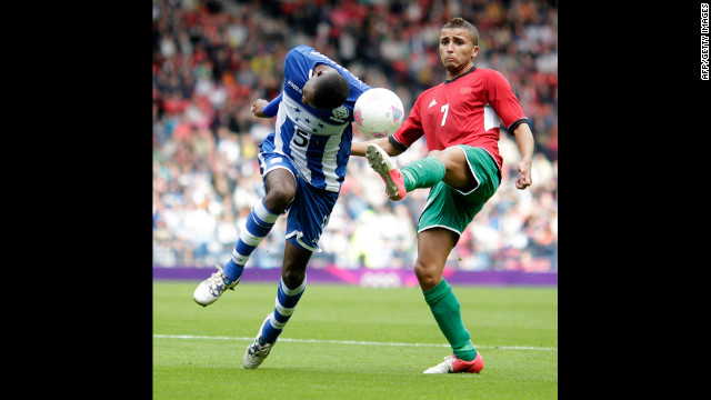 Honduras' Jose Velasquez, left, gets challenged by Zakaria Labyad of Morocco during Thursday's match.